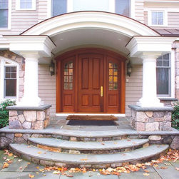 HeartWood Traditional Doors - Custom segment top mahogany door with sidelites.