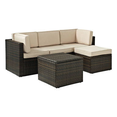 Crosley - Palm Harbor 5-Piece Outdoor Wicker Seating Set - Enjoy entertaining outside with our elegantly designed all-weather outdoor resin wicker sectional set. This finely crafted collection features intricately woven wicker over durable steel frames and UV/Fade resistant cushions providing both comfort and style. This set is sure to provide lasting enjoyment in any outdoor setting. Includes two corner chairs, one center chair, an ottoman and a coffee sectional table.