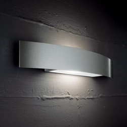 """Status - contemporary vanity lamp LP 1017/40, /55, /70 - The Status wall sconce has been designed by Arcadia for Light for Sillux. This light comes with a stainless steel lampshade. Available in three sizes.  Product description:  The Status wall sconce has been designed by Arcadia for Light for Sillux. This light comes with a stainless steel lampshade. Available in three sizes. Perfectly for mirrors or vanity areas. Details:                         Manufacturer:             Sillux                            Design:                         Arcadia for light                                         Made in:            Italy                            Dimensions:                         small: Height: 3 1/2"""" (9 cm) X Length: 15 3/4"""" (40 cm) X Projection: 4 1/4"""" (11 cm)                          medium: Height: 3 1/2"""" (9 cm) X Length: 21 3/4"""" (55 cm) X Projection: 4 1/4"""" (11 cm)             large: Height: 3 1/2"""" (9 cm) X Length: 27 1/2"""" (70 cm) X Projection: 4 1/4"""" (11 cm)                                         Light bulb:             small: 1 x 100W R7s Halogen              medium: 1 x 150W R7s Halogen              large: 2 x 150W R7s Halogen                            Material             chrome, glass"""