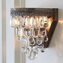 """Clarissa Glass Drop Sconce, Antique Silver finish - Bring holiday sparkle to a living or dining space with this crystal-draped sconce. Suspended from a filigreed antique-silver crown, it features oversized glass teardrops and raindrops with a faceted-glass globe at the bottom. 6"""" wide x 6.5"""" deep x 6.5"""" high Glass drops suspended from an antique-silver filigreed crown crafted of iron. Some assembly required; individual droplets must be attached by hand. Hardwire; professional installation recommended."""