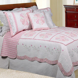 None - Daisy Field Quilt Set - Pink patchwork daisies and floral embroidered border highlight this quilted Daisy Field quilt set. Finished with clam scalloped edges, this Daisy Field quilt set reverses to a striped floral pattern and includes coordinating shams.