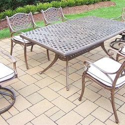 Oakland Living - 7-Pc Boat Shaped Dining Set - Includes one dining table, four arm dining and two swivel rockers with cushion. Metal hardware. Fade, chip and crack resistant. Umbrella hole. Traditional lattice pattern and scroll work. Warranty: One year limited. Made from rust free cast aluminum. Antique bronze hardened powder coat finish. Minimal assembly required. Table: 70 in. L x 38 in. W x 29 in. H (75 lbs.). Arm chair: 21.5 in. W x 23 in. D x 34 in. H (27 lbs.). Swivel rocker chair: 23 in. W x 17.5 in. D x 38 in. H (33 lbs.)This 7 pc Table dining set is the prefect piece for any outdoor dinner setting. Just the right size for any backyard or patio. The Oakland Mississippi Collection combines southern style and modern designs giving you a rich addition to any outdoor setting. Each piece is hand cast and finished for the highest quality possible.
