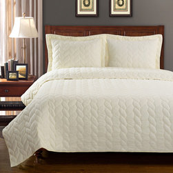 None - Ashley Braided Cotton 3-piece Quilt Set - The Ashley braided quilt set will bring style and warmth to your bedroom with its subtle weaving and wonderful softness. Made from 100-percent cotton,this gorgeous set comes with matching shams to complete the look.