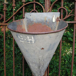 Antique French Galvanized Grape Harvesting Container - This is such a clever idea. Old grape harvesting containers are the perfectly unique hanging planter. I love the weathered galvanized metal and the conical shape.