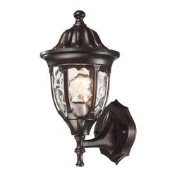 Elk Lighting - 45000/1 Glendale 1-Light Outdoor Sconce in Regal Bronze - The beauty of water glass is encased in a regal bronze, cast aluminum frame with a decorative top cap that has ribbed detailing which adds to the classic allure. Complete your outdoor presentation with a versatile array of coordinating fixtures in this series for stunning curb appeal.