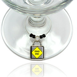 "Made on Terra - Dead End Basic Yellow Road Sign Wine Glass Silver Charm - Your guests have arrived and the atmosphere is electric. A sip of wine here, a sip of a cocktail there and you find the conversation turning to the charming baubles you've placed on the glasses, something special you chose for each of your eclectic guests. They love them and appreciate your thoughtfulness. You love them for their uniqueness and that no one forgets which glass they were using.  Choose from Made on Terra's many designs for the best party ever. Ring is 1"" diameter; measures 2"" from top of ring to bottom of charm. Made of metal and plastic. Sold individually."