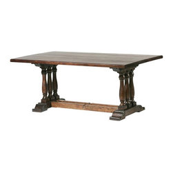 William Sheppee - Tuscan Trestle Dining Table - TUS051 - Shop for Dining Tables from Hayneedle.com! Modeled after tables found in coastal Italian tradition the Tuscan Dining Table will add extra amore to your dining space. There's no denying this dining table's presence - the six columned turned legs walnut finish and shaped feet all combine to make a look that's perfect for classic decors. The table is constructed of solid acacia wood and makes the perfect companion to other pieces in the Tuscan dining collection. You have your choice of a 6- or 7-foot length and both seat up to four diners.About William Sheppee USA Ltd.Known worldwide for its distribution of fine Indian architectural pieces and antiques William Sheppee USA Ltd. is the Ohio-based American branch of the Salisbury Wiltshire company. Named for founding director William Sheppee the company was founded in London in 1988 and prides itself on its fine craftsmanship and hand carving that draws its inspiration from nineteenth-century Colonial design. The company uses only the finest mango acacia and sheesham wood at its India-based facility and William Sheppee pieces rank as among the finest on the market today.
