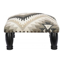 Ankara Legged Ottoman - Winter is the season to put your feet up, in perfect after-ski fashion. Maybe it's my idealized vision of great Colorado lodges, but this Navajo-inspired ottoman looks like it would be perfect for the job.