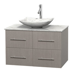 "Wyndham Collection - Centra 36"" Grey Oak SGL Vanity, Carrera Marble Top, Arista Sink, No Mrr - Simplicity and elegance combine in the perfect lines of the Centra vanity by the Wyndham Collection. If cutting-edge contemporary design is your style then the Centra vanity is for you - modern, chic and built to last a lifetime. Available with green glass, pure white man-made stone, ivory marble or white carrera marble counters, with stunning vessel or undermount sink(s) and matching Mrr(s). Featuring soft close door hinges, drawer glides, and meticulously finished with brushed chrome hardware. The attention to detail on this beautiful vanity is second to none."