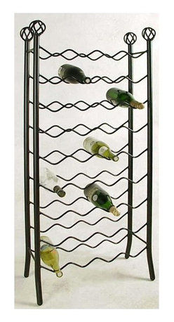 Grace Collection - Iron Wine Rack - 36 Bottle - Great for Creati - Finish: IvorySail from Trentino to The Russian River Valley to Châteauneuf-du-Pape to Burgundy to Santa Barbara without leaving your lounging area with your supremely crafted Wrought Iron Wine Rack, a radiant room accessory that will capture your space.  Its hardy construction will take the knocks and spills of busy restaurant life and still look great in years to come!  The wrought iron design of this standing wine rack is at once unique and strong, with a swirling wave pattern and a simple racking system that will accommodate up to 36 bottles of wine.  Decorative scalloped rows include iron supports with finials.  Elegantly scrolled wrought iron construction is available in your choice of twelve different metal finishes to create a focal wine rack for your room while offering handy and stylish storage. * Wrought iron construction. Many metal finish options available. 24W x 11D x 52H in.. Weight: 0.6 lbs.