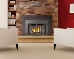 Napoleon Direct Vent Gas Fireplace Insert with Radiant Ironwood Log Set - Add warmth and beauty to your living space with the Napoleon Direct Vent Gas Fireplace Insert with Radiant Ironwood Log Set. This insert gives your standard masonry fireplace a welcome upgrade and uses either natural gas or liquid propane fuels. It features 24000 BTUs of heating power and comes with a heat radiating ceramic glass panels. Its Ironwood log set offers a realistic look with dancing flames that set the mood. To ensure the safety of the exhaust system, it is recommended that you use a professional installer. A licensed contractor should be contacted for installation of all products involving gas lines. About Napoleon Napoleon got its start in 1976 as a steel fabrication business launched by Wolfgang Schroeter in Barrie, Ontario, Canada. Solid cast iron two-door stoves were became a single glass door model with Pyroceram high-temperature ceramic glass. In 1981 the name Napoleon was coined for their items. Over the years Napoleon has led the way with innovative engineering and design. They are now North America's largest privately owned manufacturer of quality wood and gas fireplaces, gourmet gas and charcoal grills, outdoor living products, and heating and cooling products.
