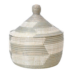 Warming Basket - Gray - Gray and white basket or hamper woven by rural Wolof women in Senegal. Use for small item storage, toy storage or as room decor. Hand crafted from cattail stalks and salvaged plastic strips from local factories. Features a fitted lid. Sturdy and well built, this basket will last for years with little to no maintenance.