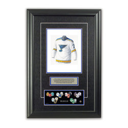 """Heritage Sports Art - Original art of the NHL 1968-69 St. Louis Blues NHL Team jersey - This beautifully framed piece features an original piece of watercolor artwork glass-framed in an attractive two inch wide black resin frame with a double mat. The outer dimensions of the framed piece are approximately 17"""" wide x 24.5"""" high, although the exact size will vary according to the size of the original piece of art. At the core of the framed piece is the actual piece of original artwork as painted by the artist on textured 100% rag, water-marked watercolor paper. In many cases the original artwork has handwritten notes in pencil from the artist. Simply put, this is beautiful, one-of-a-kind artwork. The outer mat is a rich textured black acid-free mat with a decorative inset white v-groove, while the inner mat is a complimentary colored acid-free mat reflecting one of the team's primary colors. The image of this framed piece shows the mat color that we use (Medium Blue). Beneath the artwork is a silver plate with black text describing the original artwork. The text for this piece will read: This is an original watercolor painting of the 1968-69 St. Louis Blues jersey and was used in the NHL """"Next Six"""" print below and thousands of NHL """"Next Six"""" products that have been sold across North America. This original piece of art was painted by artist Tino Paolini for Maple Leaf Productions Ltd. Beneath the silver plate is a 3"""" x 9"""" reproduction of a well known, best-selling print that celebrates the history of """"The Next Six"""" 1967 expansion teams. The print beautifully illustrates the chronological evolution of each team's uniform and shows you how the original art was used in the creation of this print. If you look closely, you will see that the print features the actual artwork being offered for sale. The piece is framed with an extremely high quality framing glass. We have used this glass style for many years with excellent results. We package every piece very carefully in a d"""