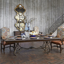 Frontgate - Scrolled Metal Dining Table - Solid oak plank tabletop. Rustic distressed finish with exposed peg construction detailing at the corners. Scrolled metal base is finished is aged gold. Arrives in two pieces. Rustic and refined combine in our Scrolled Metal Dining Table. Featuring a distressed solid oak plank top with exposed peg construction details and an aged gold finish on the metal base, this Mediterranean-inspired provides graceful function in any dining room.  .  .  .  .