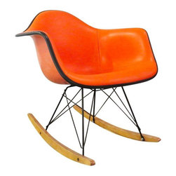 Eames - Pre-owned Vintage Orange Eames Shell Rocker - All Original - We're swooning over this orange on orange Eames shell rocker! Originally designed in 1948 by designer Charles Eames, the rocker originally consisted of fiberglass-reinforced plastic molded into a deep seat with a high backrest and birch or maple rockers underfoot. One of the first products in Charles and wife Ray's line of mass-produced molded plastic chairs, it was crafted to distribute the sitter's weight and pressure comfortably.    This chair is all original with fiberglass shell, vinyl upholstery, steel base and wood rocker glides. The chair is in great vintage condition, with slight wear to the seat, but appropriate for the age of the chair. It is missing the paper Herman Miller tag on the bottom.
