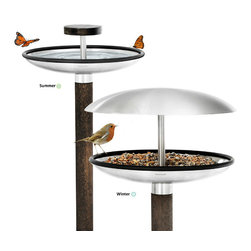 Blomus - FUERA Bird Feeder / Bird Bath - The Blomus FUERA Bird Feeder will attract many song birds to your backyard garden and transform a little patch of grass into an extraordinary oasis. While the stainless steel top protects food from rain and snow, this birdfeeder has the dual function of becoming a bird bath too, just remove the stainless steel top and voila'.