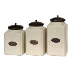 "IMAX CORPORATION - Ivory Canisters - Set of 3 - An aged cream finish gives this canister set a classic look. Each canister has a brown lid and features its own content label. For storing your sugar, cookies and flour, this set of ceramic canisters is perfect. Food safe. Set of 3 in various sizes measuring around 17.5""L X 11.25""W X 14""H each. Shop home furnishings, decor, and accessories from Posh Urban Furnishings. Beautiful, stylish furniture and decor that will brighten your home instantly. Shop modern, traditional, vintage, and world designs."
