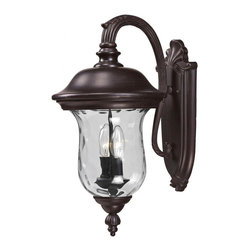 Two Light Bronze Clear Waterglass Glass Wall Lantern - Traditional charm emanates from this medium outdoor wall mount fixture, which pairs clear water glass with rubbed bronze hardware for a timeless look.