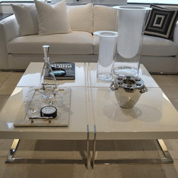 Showroom Pieces - White Lacquer coffee table with stainless steel legs. For more info give us a call at (305)576-4566!
