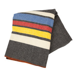 Allegheny Throw, Oxford - Here's a little warmth sourced straight from the East Coast. Woven in Woolrich's mill in Pennsylvania, this blanket was inspired by the classic patterns that first shaped the company. Each blanket is crafted from 15 ounces of 100% wool with an engineered stripe. Dry clean only. Single-ply with orange whipstitch trim. Measures 56 inches wide by 70 inches long.