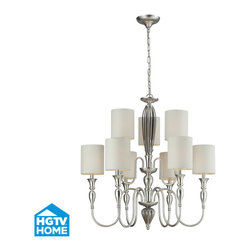 ELK Lighting - ELK Lighting 46035/6+3 Martique 9 Light Chandeliers in Silver Leaf - Sophisticated styling and a sleek two-tone finish characterize the Chrome Glass collection. The reflections of a ribbed chrome plated glass center column is subdued by a silver leaf finished framework of curved arms and tall candlestick style bobeches. The combination of these shiny and satin surfaces results in a uniquely refreshing appearance. Textured white linen drum shades diffuse the light onto the fixture, further highlighting the dazzling finish combination.