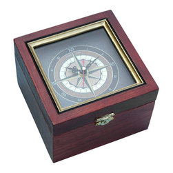 Nautical Compass Rose Clock in Wooden Box - This beautiful nautical compass rose clock in wooden box has an accurate quartz movement and is built into the lid of a solid wood box.  The wooden box has a distressed antique finish and the face of the clock is a traditional nautical compass rose.  The hand crafted box has brass hinges and a front brass clasp, and the bottom of the box is covered with black felt.  The Compass Rose Clock is perfect for the dresser or adorning your office, and the box opens to hold your billfold, keys, cell phone, jewelry and watch.  The face of the clock is protected with glass, and the quartz clock requires a single common AA battery.  The boxed clock measures 5 3/8 inches (13.7 cm) square, and 3 7/8 inches (9.8 cm) tall, and weighs 13.1 ounces (372 grams).  The interior of the box measures 4 3/8 inches (11.1 cm) square and 2 5/8 inches (6.7 cm) deep.