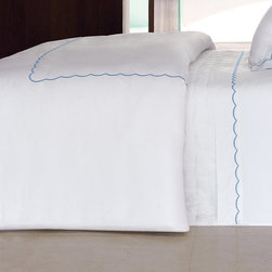 """Frontgate - Yves Delorme Douce Duvet Cover - Yves Delorme has been a family-owned purveyor of fine linens since 1845. Made in France of Egyptian cotton, sateen woven for luxurious softness. 300 thread count. Simple design pairs well with other bedding items. Knife-edge duvet cover has button closure. If you love the look of hotel sheets, you'll appreciate Yves Delorme's elegant variation on this theme. In the Douce Collection, the traditional straight-lined hotel hem is replaced with a more feminine scallop. This charming detail accents the crisp white Egyptian cotton field of the duvet cover, flat sheet, pillowcases and shams.. . . . . Pair with the Yves Delorme solid-white sateen 18"""" deep fitted sheet with elastic on all sides. Machine wash and tumble dry low; see product label for further instructions."""
