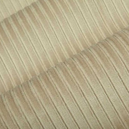 Viva Upholstery Fabric in Buckwheat - Viva in Buckwheat is a beige velvet upholstery fabric with channeled stripes. This fabric is incredibly durable and has a soft texture that's ideal for reupholstering furniture, or for creating bedding and pillows. Available in current colors, this velvet plush has a feel that's irresistible. Made from 100% Polyester. Fire Rating UFAC Class 1. Cal Tech Bulletin #117, SEC.E. 100,000 double rubs. 54″ wide.