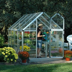 Palram Snap & Grow 6 x 8 ft. Greenhouse - Additional Features Gorgeous greenhouse is easy to assemble Window features weather-stripping Adjustable roof ventilation keeps plants healthy Heavy duty aluminum frame Great for growing in all climates Limited 5 year warranty Gorgeous and easy to assemble the Palram Snap & Grow 6 x 8 ft. Greenhouse is perfect for turning your backyard into a sanctuary. The crystal-clear SnapGlas panels lock into place easily and are virtually unbreakable. The preassembled split-style door provides easy access and ventilation while the window has weather stripping and the roof features an adjustable vent to help keep your plants healthy. Great for growing in all seasons you'll love having plants flowers and produce just a few feet from your own front door.
