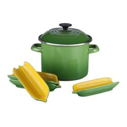 Le Creuset Sweet Corn Stockpot Set - If sweet corn is one of your family's favorite summer past-times, you will love having the Le Creuset Sweet Corn Stockpot Set to richen the experience. The high-quality carbon steel pot is coated in a fresh green porcelain enamel finish, and equipped with two carrying handles for easy transportation. Four corn dishes are ideal for keeping your ears fully buttered, not to mention an adorable addition to your dinner table. About Le Creuset of America Inc.From its cast iron cookware to its teakettles and mugs, Le Creuset is a global standard of inimitable color and quality. Founded in 1925 in the northern French town of Fresnoy-Le-Grand, Le Creuset still produces enameled cast iron in its original foundry. Its signature color, Flame, was modeled after the intense orange hue of molten cast iron within a cauldron (or creuset in French), and has been a Le Creuset bestseller from the company's first year to the present day.Though best known for its vibrantly colored cookware and original inventions such as the Dutch oven, Le Creuset has also forged a name as a creator of stoneware mugs and enamel-coated stainless steel teakettles. The style and performance of Le Creuset's Cafe Collection and tea accessories are rooted in classic French cookware: bold colors, cylindrical loop handles, unmatched thermal resistance and heat distribution, and of course the iconic Le Creuset three-ring accent. Through its consistent qualities of authenticity, originality, and innovation, Le Creuset maintains a connection to both heritage and modernity.