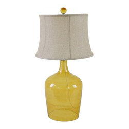 Orange Bottle Table Lamp With Linen Shade - Simple style and elegance are key features in this Orange Bottle Table Lamp With Linen Shade. The see-through base will help disperse the light throughout the area, and it has a large fabric shade that ensures the lamp casts a soft, romantic glow in the room.