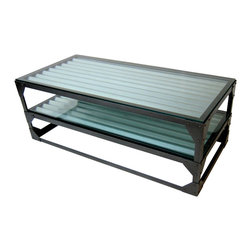 "Palm Metal Designs - Steel Coffee Table - This industrial style coffee table has a unique look with corrugated underlay with 3/8"" thick glass tops.  It is constructed out of thick steal and held together with clean welds and hot rivets.   This clean coffee table is finished with a textured hardened powder coat.  Let this table be the center piece to your living room and catch the envious eyes of others."