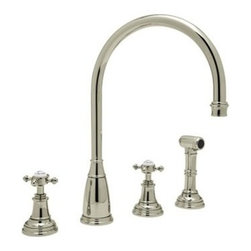 Rohl Perrin & Rowe U.4735X-STN Double Handle Kitchen Faucet - Cleanliness is next to good design in the Rohl Perrin & Rowe U.4735X-STN Double Handle Kitchen Faucet. Crafted with durable solid brass in a soft satin nickel finish, this fixture is designed for installation with four faucet holes, ¼-turn ceramic disc valves, and a patented diverter. Dual cross-style knobs control a steady 1.8 gallon per minute flow, and the high-arched swivel spout provides clearance for large pots and pans. A coordinating insulated sidespray blasts baked-on food and debris from dishes. Limited lifetime warranty included. Product SpecificationsHandle style: KnobValve type: ¼-turn ceramic discFlow rate: 1.8 gallons per minuteSpout height: 8.88 inchesAbout RohlNamed for the family that founded it in 1983, Rohl is anchored in a tradition of family values, trust, integrity, and innovation. Since starting with its original pullout faucet, Rohl has continually expanded its product line, which now includes a variety of high-quality, classically differentiated faucets and fixtures. Each is crafted to Rohl's specifications for the home, hotel, or resort.