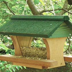 Songbird Essentials - 12 inch Pivot Roof - Western red cedar construction feeder has a green roof that pivots for easy filling. The brown body hopper holds 5 cups of seed. It hangs from a coated steel cable.
