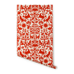 Otomi Wallpaper, Almost White/Red - This Otomi print is reminiscent of the Mexican textile of the same name. It features wildlife and nature motifs and would be especially fun in a kids' space.