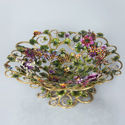 """Jay Strongwater - Claudette Floral Butterfly Bowl - MULTI COLORS - Jay StrongwaterClaudette Floral Butterfly BowlDetailsMade of brass and pewter with a brass ox finish.Hand enameled and hand set with Swarovski crystals.25.5""""Dia. x 10.5""""T.Imported base; hand decorated in New York and Rhode Island.Designer About Jay Strongwater:Jay Strongwater's love of the elegant but vividly bejeweled objet whether it's meant to rest on a tabletop or the graceful curve of a woman's neck has led him on a journey through the worlds of fashion and home furnishings. He began his career while a student at the Rhode Island School of Design. After garnering raves for a necklace he'd made his mother he took jewelry samples to open buyer days at some of New York's finest department stores and soon a burgeoning business was born. At the age of 23 Strongwater met designer Oscar de la Renta with whom he began to collaborate on jewelry designs for runway shows. The move to home accessories was delightfully serendipitous & organic. For the 1994 holiday season Strongwater sent gifts of jewel-encrusted filigree picture frames to friends fashion editors and buyers who immediately fell in love with the design. By 1998 his Jewels for the Home collection had supplanted his fashion business. In essence Strongwater created his own niche: the jeweler turning his meticulous eye and art toward a world beyond a woman's wrists neck and ears."""