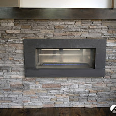 Contemporary Indoor Fireplaces by Kanvi Homes