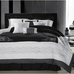 Chic Home Florence Embroidered Comforter Set - Modern yet elegant the Chic Home Florence Embroidered Comforter Set is a must in your contemporary bedroom. This plush and plump comforter has a bold design in your choice of color with intricate embroidery for chic style. Generously sized and overfilled, this comforter set includes everything you need to spice up your bedroom. It has a soft polyester exterior with 100 GSM brushed microfiber fill. This set is machine-washable in cold on the gentle cycle. Tumble dry on low and iron as needed. It comes in your choice of size, color, and in either an 8- or 12-piece set.Bedding Set Components:8-piece Set: Comforter + Bedskirt + 2 pillow shams + 2 square 18 x 18-inch cushion + one 20 x 20-inch cushion + one 9 x 14-inch breakfast pillow 12-piece Set: Comforter + Bedskirt + 2 pillow shams + Sheet set: 1 flat sheet, 1 fitted sheet, 2 pillowcases + 2 square 18 x 18-inch cushions + one 20 x 20-inch cushion + one 9 x 14-inch breakfast pillowDimensions:Queen Comforter: 90 x 90 inchesQueen Bedskirt: 60 x 80(2) Queen Shams: 20 x 26King Comforter: 110 x 90 inchesKing Bedskirt: 78 x 80(2) King Shams: 20 x 36