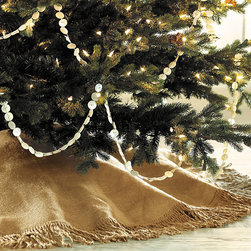"""Ballard Designs - Fringed Burlap Tree Skirt- 60 in. - Tie closures. Off-White cotton duck backing. A warm, neutral alternative to traditional red and green, our Burlap Christmas Tree Skirt is hand sewn of textured 100% burlap with 4"""" fringe. Burlap Tree Skirt features: . . *Monogramming available for an additional charge.*Allow 3 to 5 days for monogramming plus shipping time.*Please note that personalized items are non-returnable."""
