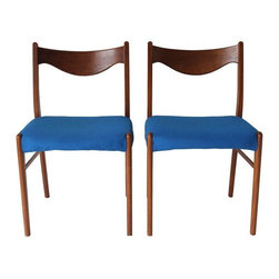 "Pre-owned Danish Modern Chairs - A Pair - A pair of teak Danish Mid-Century Modern chairs with blue fabric. The chairs are marked, made in Denmark. These chairs have a perfect balance of lightness and warmth with smooth contoured wood frames and upholstered seats. These chairs would look great at a dining table or as extra seating in a living space.     Seat height measures 17""."