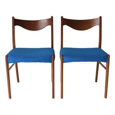 "Used Danish Modern Chairs - A Pair - A pair of teak Danish Mid-Century Modern chairs with blue fabric. The chairs are marked, made in Denmark. These chairs have a perfect balance of lightness and warmth with smooth contoured wood frames and upholstered seats. These chairs would look great at a dining table or as extra seating in a living space.     Seat height measures 17""."