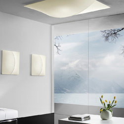 """Axo - Axo Nelly ceiling lamp - UPS140 (large) - The large Nelly ceiling lamp (UP NEL S140) from Axo was designed by Manuel Vivian and made in Italy. The large Nelly ceiling lamp is for indoor installation and is available as a wall fixture. This collection is made with coverings of removable and washable elastic fabric and is available in white, white pattern and ivory pattern. This fascinating light sculpture, created by soft and extended curves, gives your modern home the perfect touch.  Products description: The large Nelly ceiling lamp (UP NEL S140) from Axo was designed by Manuel Vivian and made in Italy. The large Nelly ceiling lamp is for indoor installation and is available as a wall fixture. This collection is made with coverings of removable and washable elastic fabric and is available in white, white pattern and ivory pattern. This fascinating light sculpture, created by soft and extended curves, gives your modern home the perfect touch. Details:                         Manufacturer:                         Axo                                         Designer:                         Manuel Vivian                                         Made  in:            Italy                            Dimensions:                         Height: 9.9"""" (25cm) X Width: 55.2"""" (140cm)                                                     Light bulb:                                      4 X 100W E26 Incandecent or             4 X 20W E26 Flourescent or             1 X 55W 2GX13                                         Material                         Metal, fabric                               Designer Manuel Vivian:  Born in Venice in 1971, his interest in design started when he was very young, in particular with reference to blown glass, also thanks to his family business. After succeeding in making the first projects in glass, Manuel enlarged his range of interests to the various fields of Interior Design. Since AXO Light was born in 1997, he has been cooperating constantly"""