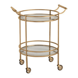 Wade Antique Brass/Glass Bar Cart - Warm and handsome, the Wade Bar Cart in antique brass adds an air of the sumptuous restaurant in your home, making entertaining chic and providing useful additional surface for cozy family dining. The round cart has four castered legs and two round glass surfaces, each bordered in antiqued mirror and surrounded by lustrous brass rails, to maximize its utility as a tea cart or dessert cart. Handles at the top allow it to be lifted over thresholds with ease.
