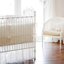 New Arrivals - New Arrivals Crib Bedding Velvet Baby Ivory - Reflecting the whimsy and joy of life, New Arrivals delivers fun and function to a child's room. An elegant nursery design, this crib bedding delivers a beautiful combination of solid and floral velvet prints. The ivory sheet, skirt, receiving blanket and bumper collection offers sets of two, three or four coordinating pieces. Optional boudoir pillow, changing pad cover and two curtain panels are available. Handmade in the USA.
