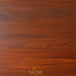 Ipe / Brazilian Walnut Solid Exotic Hardwood Flooring - Brazilian walnut, commonly known as Ipe, is a very hard walnut species. It's great for high traffic areas and has a mix of straight grains and curved patterns. This wood has a moderate variation in color ranging from a deep brown heartwood to a medium tan sapwood. This is a perfect wood to give off a sense of warmth and elegance.