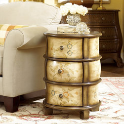 "Hammary - Hidden Treasures Round Accent Chest - Hammary's Hidden Treasures collection is a fine assortment of unique accent pieces inspired by some of the greatest designs the world over. Each selection is rich in Old World icons and traditions. Every piece in this collection is crafted with the upmost attention to fine details. Each item is a work of art from brass nailhead trim and exquisite hand-painting to elegant shaping and decorative trim. Wide varieties of materials are used to create a perfect look and fine quality which includes exotic woods, leather, and stone to raffia and glass. The wide variety of finishes, hardware, beautiful carvings and other final touches offer unmatched versatility for any room in your home. Hidden Treasures features cocktail tables, occasional and accent pieces, trunks, chests, consoles, wine racks, desks, entertainment units and interesting storage pieces. Place one in a comfortable reading nook. . . in the family room for flair and variety. . . in the foyer for a welcome look. . . in a bedroom for a cozy style. . . or in the office for function and versatility. The pieces in this collection mix beautifully with any decorating style and will easily become the focal point in any setting.; Hidden Treasures Collection; Finish:; 3 Drawers; Flower and Vine Painting; 2-Tone Finish; Weight: 68 lbs.; Dimensions: 20""W x 20""D x 28. 25""H"