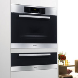 Warming Drawers by Miele - Features Full extension drawer. Unique, open-sided design. Convection heating system (fan-assisted). Dual heating system. 4-hour timer Temperature settings from 104°F to 185°F, including cup, plate and food temperature settings. Touch controls.
