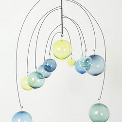 """Zephyrine Mobile, Blue - Created by SkLO Studio, a collaboration between a Czech glass blower and an American husband-wife design team, this art installation adds modern whimsy to every open space.  Includes two 12"""" steel extension links. Blown glass, powder-coated steel, brass chain."""