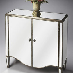 Butler - Masterpiece Mirrored Door Chest - Adjustable shelf behind two doors with storage space. Rich wood trim. Tapered legs. Beveled top edges. Shaped door fronts. Antiqued mirror inlays on its top, side and front surfaces. Antique brass finished door pulls. 38 in. W x 14 in. D x 37 in. H (144 lbs.)