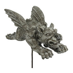 15 Inch Long Flying Gargoyle Concrete Garden Stake - This cool solid concrete yard stake features a winged gargoyle flying through the air in a Superman pose. The statue measures 6 1/2 inches tall, 15 inches long and 7 inches wide. The solid metal stake is 9 1/2 inches long, so you can display him flying just above the grass in your yard. He can also be placed in a flower pot to give your garden some height contrast. It`s great for anyone who loves gargoyles.